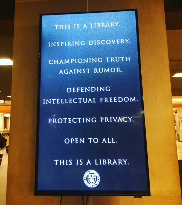 Sign in the Olin Library at Cornell University