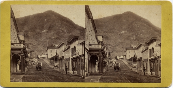 The Barton House was the large building shown at the top of the hill on Taos Street in Georgetown. It served as a gathering place for the numerous professionals who lived in the neighborhood. Photograph taken c. 1880.