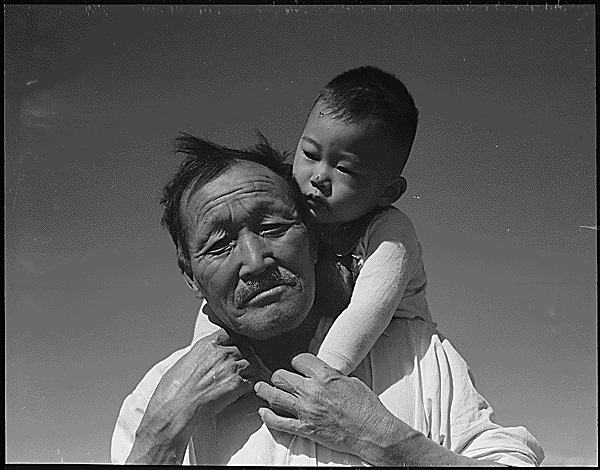 Grandfather and grandson of Japanese ancestry at the Manzanar Relocation Center, the War Relocation Authority center in Manzanar, California.