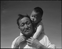 Manzanar Relocation Center, Manzanar, California. Grandfather and grandson of Japanese ancestry at this War Relocation Authority center.