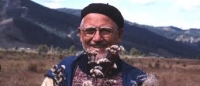 William A Weber holding Ptilagrostis cf. porteri and Saussurea sp., Yabagan Pass, Altai, 1978.